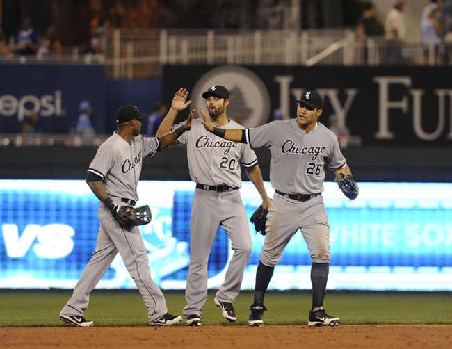 Aug 20, 2013; Kansas City, MO, USA; Chicago White Sox  outfielders Alejandro DeAza (left) Jordan Danks (20) and Avisail Garcia (26) celebrates after the game against the Kansas City Royals at Kauffman Stadium. Chicago won the game 2-0. Mandatory Credit: John Rieger-USA TODAY Sports