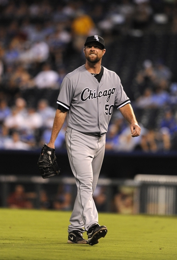Aug 20, 2013; Kansas City, MO, USA; Chicago White Sox  starting pitcher John Danks (50) smiles as he leaves the field in the eighth inning against the Kansas City Royals at Kauffman Stadium. Chicago won the game 2-0. Mandatory Credit: John Rieger-USA TODAY Sports