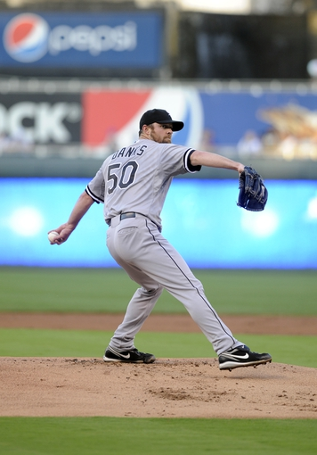 Aug 20, 2013; Kansas City, MO, USA; Chicago White Sox  starting pitcher John Danks (50) throws a warmup pitch in the first inning against the Kansas City Royals at Kauffman Stadium. Chicago won the game 2-0. Mandatory Credit: John Rieger-USA TODAY Sports