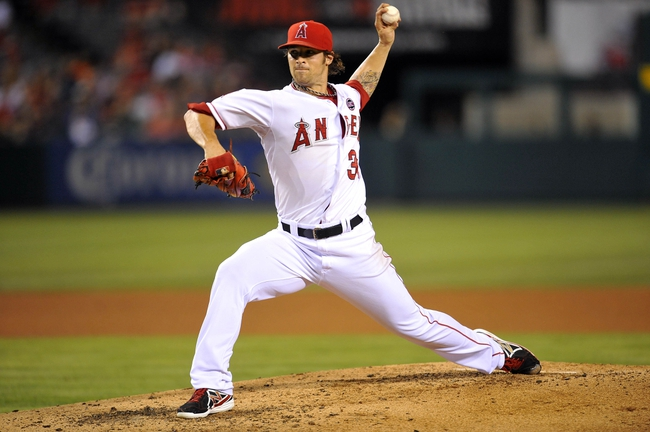 August 20, 2013; Anaheim, CA, USA; Los Angeles Angels starting pitcher C.J. Wilson (33) pitches during the fifth inning against the Cleveland Indians at Angel Stadium of Anaheim. Mandatory Credit: Gary A. Vasquez-USA TODAY Sports