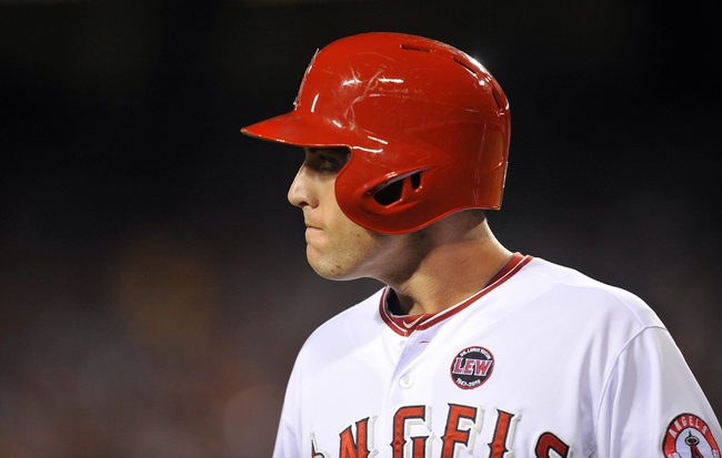 August 20, 2013; Anaheim, CA, USA; Los Angeles Angels center fielder Peter Bourjos (25) reacts after striking out in the fifth inning against the Cleveland Indians at Angel Stadium of Anaheim. Mandatory Credit: Gary A. Vasquez-USA TODAY Sports