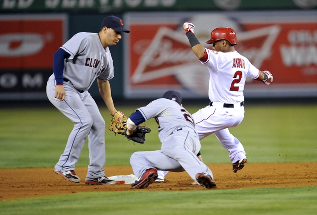 August 20, 2013; Anaheim, CA, USA; Los Angeles Angels shortstop Erick Aybar (2) steals second in the sixth inning against the tags of Cleveland Indians shortstop Asdrubal Cabrera (13) and second baseman Jason Kipnis (22) at Angel Stadium of Anaheim. Mandatory Credit: Gary A. Vasquez-USA TODAY Sports