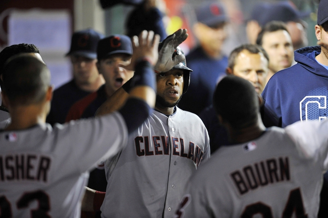 August 20, 2013; Anaheim, CA, USA; Cleveland Indians catcher Carlos Santana (41) is greeted after hitting a solo home run in the seventh inning against the Los Angeles Angels at Angel Stadium of Anaheim. Mandatory Credit: Gary A. Vasquez-USA TODAY Sports