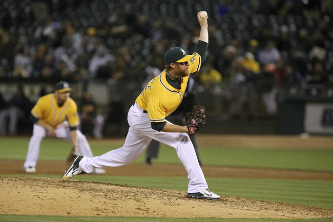 Aug 20, 2013; Oakland, CA, USA; Oakland Athletics relief pitcher Sean Doolittle (62) pitches the ball against the Seattle Mariners during the eighth inning at O.co Coliseum. The Seattle Mariners defeated the Oakland Athletics 7-4. Mandatory Credit: Kelley L Cox-USA TODAY Sports