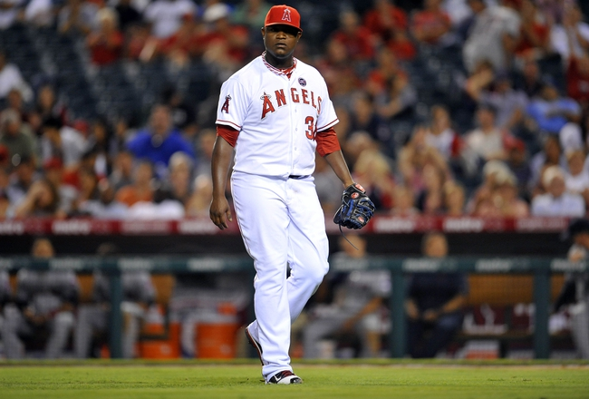 August 20, 2013; Anaheim, CA, USA; Los Angeles Angels relief pitcher J.C. Gutierrez (38) reacts after striking out the Cleveland Indians in the tenth inning at Angel Stadium of Anaheim. Mandatory Credit: Gary A. Vasquez-USA TODAY Sports