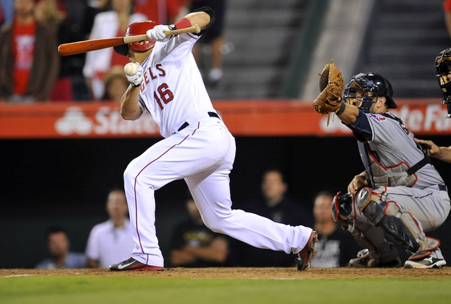 August 20, 2013; Anaheim, CA, USA; Los Angeles Angels catcher Hank Conger (16) avoids an inside pitch in the tenth inning against the Cleveland Indians at Angel Stadium of Anaheim. Mandatory Credit: Gary A. Vasquez-USA TODAY Sports