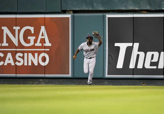 August 20, 2013; Anaheim, CA, USA; Cleveland Indians center fielder Michael Bourn (24) catches a fly ball in the twelfth inning against the Los Angeles Angels at Angel Stadium of Anaheim. Mandatory Credit: Gary A. Vasquez-USA TODAY Sports