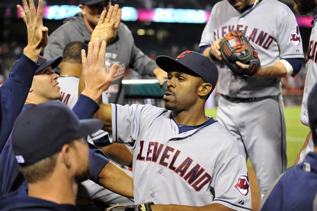 August 20, 2013; Anaheim, CA, USA; Cleveland Indians center fielder Michael Bourn (24) is congratulated after catching a deep fly ball in the twelfth inning against the Los Angeles Angels at Angel Stadium of Anaheim. Mandatory Credit: Gary A. Vasquez-USA TODAY Sports
