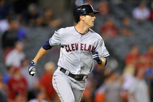 August 20, 2013; Anaheim, CA, USA; Cleveland Indians right fielder Drew Stubbs (11) runs the bases after hitting a two run home run in the fourteenth inning against the Los Angeles Angels at Angel Stadium of Anaheim. Mandatory Credit: Gary A. Vasquez-USA TODAY Sports