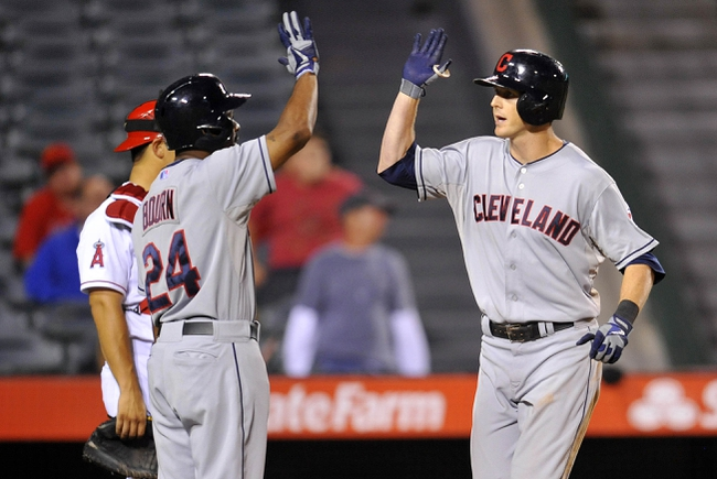 August 20, 2013; Anaheim, CA, USA; Cleveland Indians right fielder Drew Stubbs (11) is congratulated by center fielder Michael Bourn (24) after hitting a two run home run in the fourteenth inning against the Los Angeles Angels at Angel Stadium of Anaheim. Mandatory Credit: Gary A. Vasquez-USA TODAY Sports