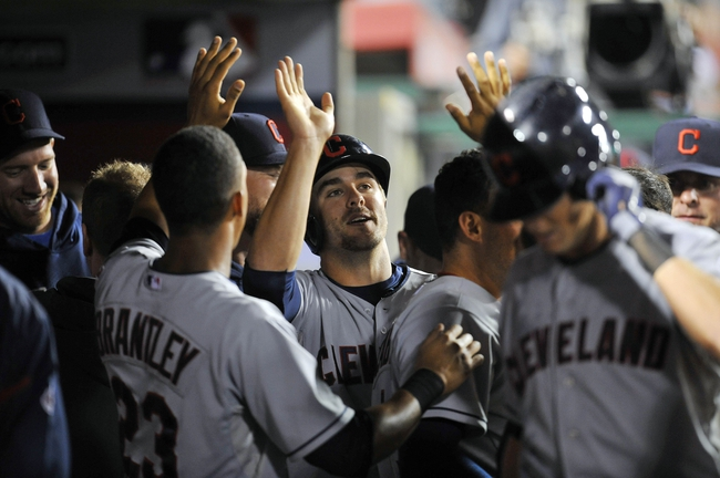 August 20, 2013; Anaheim, CA, USA; Cleveland Indians third baseman Lonnie Chisenhall (8) is congratulated after scoring a run in the fourteenth inning that was part of a two run home run hit by right fielder Drew Stubbs (11) against the Los Angeles Angels at Angel Stadium of Anaheim. Mandatory Credit: Gary A. Vasquez-USA TODAY Sports