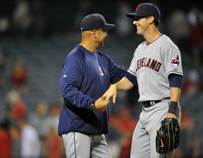 August 20, 2013; Anaheim, CA, USA; Cleveland Indians manager Terry Francona (17) celebrates the 4-1 victory with right fielder Drew Stubbs (11) against the Los Angeles Angels at Angel Stadium of Anaheim. Mandatory Credit: Gary A. Vasquez-USA TODAY Sports