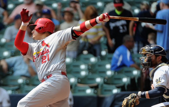 Aug 21, 2013; Milwaukee, WI, USA; St. Louis Cardinals first baseman Allen Craig hits a double to drive in a run in the 1st inning against the Milwaukee Brewers at Miller Park. Mandatory Credit: Benny Sieu-USA TODAY Sports