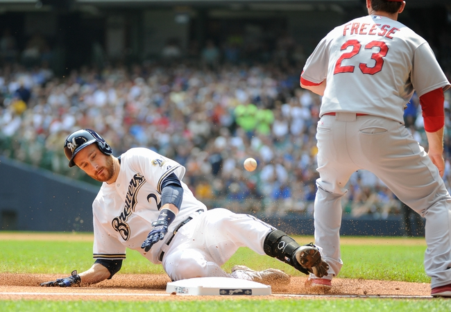 Aug 21, 2013; Milwaukee, WI, USA;  Milwaukee Brewers catcher Jonathan Lucroy (left) slides into 3rd base with a triple as St. Louis Cardinals third baseman David Freese (right) waits for the ball in the 1st inning at Miller Park. Mandatory Credit: Benny Sieu-USA TODAY Sports