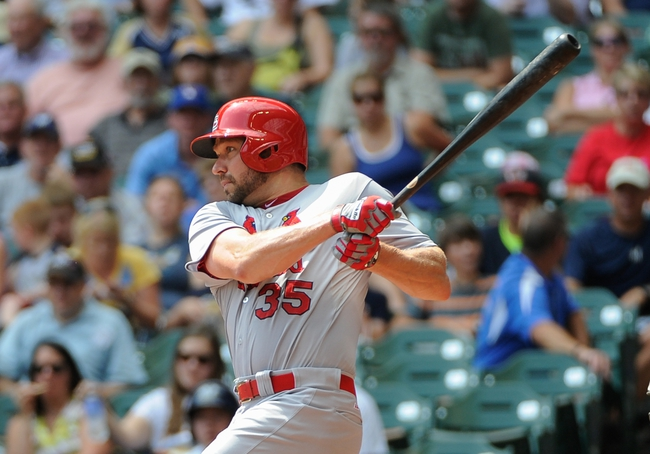 Aug 21, 2013; Milwaukee, WI, USA;  St. Louis Cardinals pitcher Jake Westbrook hits a double to drive in two runs in the 2nd inning against the Milwaukee Brewers at Miller Park. Mandatory Credit: Benny Sieu-USA TODAY Sports