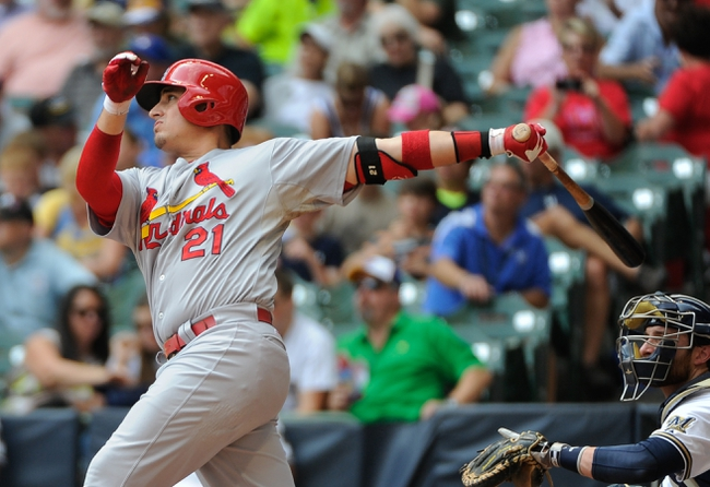 Aug 21, 2013; Milwaukee, WI, USA;  St. Louis Cardinals first baseman Allen Craig hits a solo homer in the 2nd inning against the Milwaukee Brewers at Miller Park. Mandatory Credit: Benny Sieu-USA TODAY Sports
