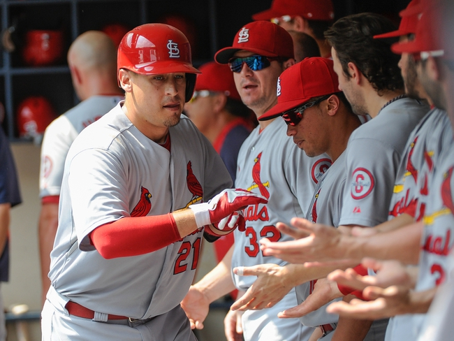 Aug 21, 2013; Milwaukee, WI, USA;  St. Louis Cardinals first baseman Allen Craig (left) celebrates in the dugout after hitting a solo homer in the 2nd inning against the Milwaukee Brewers at Miller Park. Mandatory Credit: Benny Sieu-USA TODAY Sports