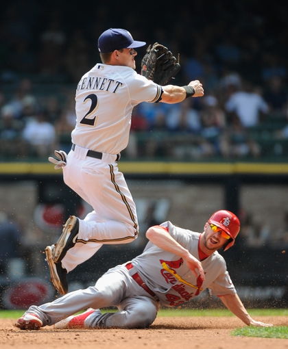 Aug 21, 2013; Milwaukee, WI, USA;  Milwaukee Brewers second baseman Scooter Gennett (2) completes a double play after forcing out St. Louis Cardinals center fielder Shane Robinson (43) at 2nd base in the 3rd inning at at Miller Park. Mandatory Credit: Benny Sieu-USA TODAY Sports