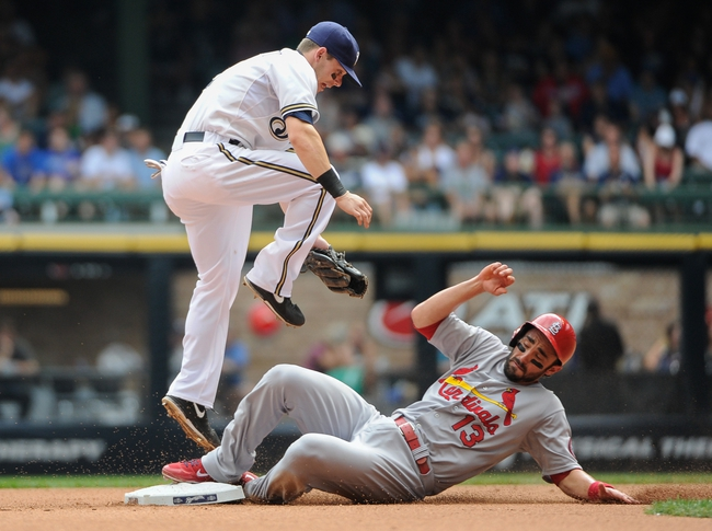 Aug 21, 2013; Milwaukee, WI, USA;  St. Louis Cardinals second baseman Matt Carpenter (right) steals 2nd base as Milwaukee Brewers second baseman Scooter Gennett (left) reached for the ball in the 4th inning at Miller Park. Mandatory Credit: Benny Sieu-USA TODAY Sports