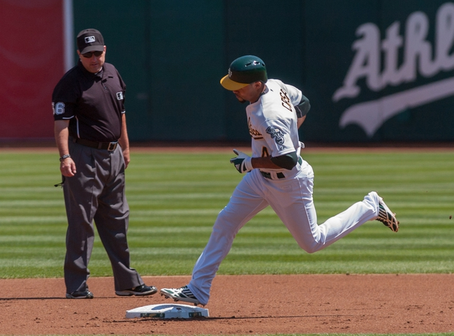 Aug 21, 2013; Oakland, CA, USA; Oakland Athletics center fielder Coco Crisp (4) rounds second base after hitting a home run against the Seattle Mariners during the first inning at O.Co Coliseum. Mandatory Credit: Ed Szczepanski-USA TODAY Sports