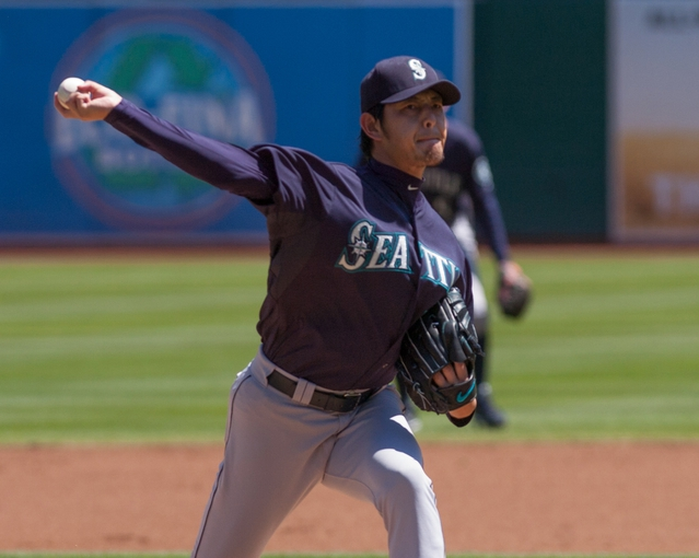 Aug 21, 2013; Oakland, CA, USA; Seattle Mariners starting pitcher Hisashi Iwakuma (18) throws a pitch against the Oakland Athletics during the first inning at O.Co Coliseum. Mandatory Credit: Ed Szczepanski-USA TODAY Sports