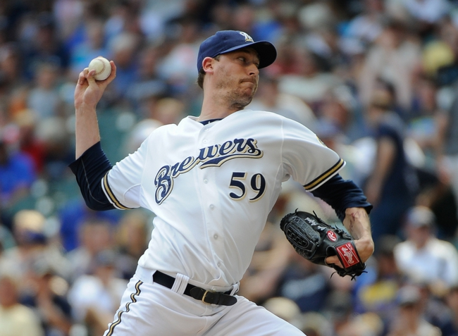 Aug 21, 2013; Milwaukee, WI, USA;  Milwaukee Brewers pitcher John Axford pitches in the 6th inning against the St. Louis Cardinals at Miller Park. Mandatory Credit: Benny Sieu-USA TODAY Sports