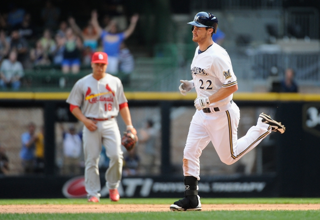Aug 21, 2013; Milwaukee, WI, USA; Milwaukee Brewers left fielder Logan Schafer (22) rounds the bases after hitting a solo homer in the 9th inning against the St. Louis Cardinals at Miller Park. Mandatory Credit: Benny Sieu-USA TODAY Sports