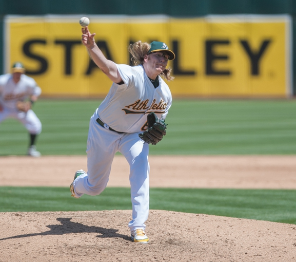 Aug 21, 2013; Oakland, CA, USA; Oakland Athletics starting pitcher A.J. Griffin (64) pitches against the Seattle Mariners during the fourth inning at O.Co Coliseum. Mandatory Credit: Ed Szczepanski-USA TODAY Sports