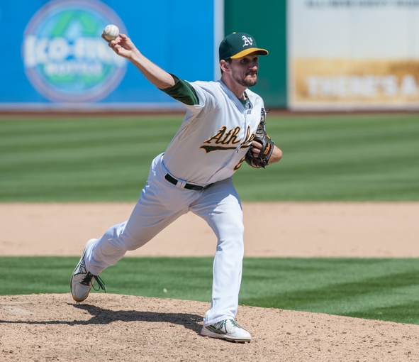 Aug 21, 2013; Oakland, CA, USA; Oakland Athletics relief pitcher Dan Otero (61) pitches in relief against the Seattle Mariners during the eighth inning at O.Co Coliseum. The Seattle Mariners defeated the Oakland Athletics 5-3. Mandatory Credit: Ed Szczepanski-USA TODAY Sports
