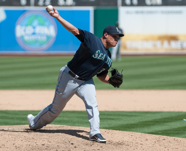 Aug 21, 2013; Oakland, CA, USA; Seattle Mariners relief pitcher Yoervis Medina (31) pitches in relief against the Oakland Athletics during the eighth inning at O.Co Coliseum. The Seattle Mariners defeated the Oakland Athletics 5-3. Mandatory Credit: Ed Szczepanski-USA TODAY Sports