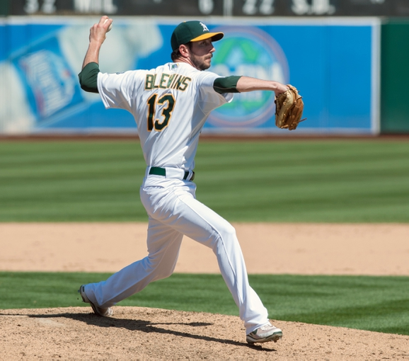 Aug 21, 2013; Oakland, CA, USA; Oakland Athletics relief pitcher Jerry Blevins (13) pitches in relief against the Seattle Mariners during the seventh inning at O.Co Coliseum. The Seattle Mariners defeated the Oakland Athletics 5-3. Mandatory Credit: Ed Szczepanski-USA TODAY Sports