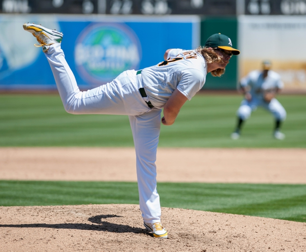 Aug 21, 2013; Oakland, CA, USA; Oakland Athletics starting pitcher A.J. Griffin (64) pitches against the Seattle Mariners during the sixth inning at O.Co Coliseum. The Seattle Mariners defeated the Oakland Athletics 5-3. Mandatory Credit: Ed Szczepanski-USA TODAY Sports