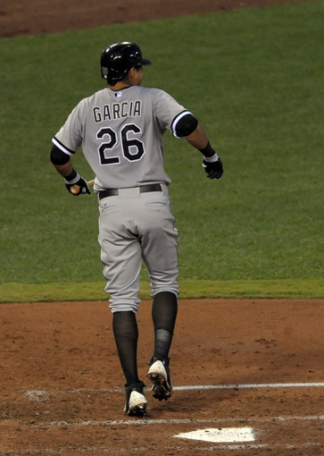 Aug 21, 2013; Kansas City, MO, USA; Chicago White Sox center fielder Avisail Garcia (26) reacts after hitting his foot on a foul ball in the fourth inning of the game against the Kansas City Royals at Kauffman Stadium. Mandatory Credit: Denny Medley-USA TODAY Sports