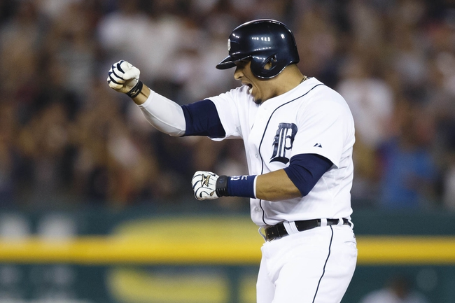 Aug 21, 2013; Detroit, MI, USA; Detroit Tigers designated hitter Victor Martinez (41) reacts after hitting an RBI double in the seventh inning against the Minnesota Twins at Comerica Park. Mandatory Credit: Rick Osentoski-USA TODAY Sports