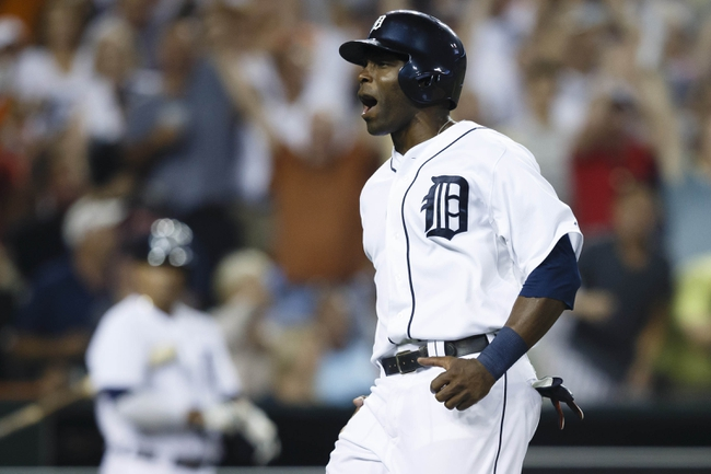 Aug 21, 2013; Detroit, MI, USA; Detroit Tigers right fielder Torii Hunter (48) reacts as he scores a run against the Minnesota Twins in the seventh inning at Comerica Park. Mandatory Credit: Rick Osentoski-USA TODAY Sports