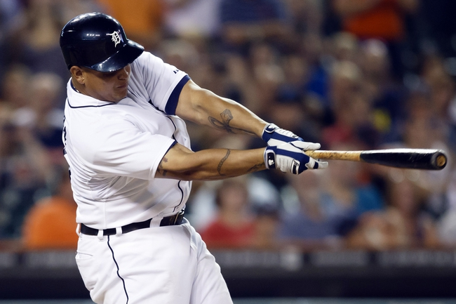 Aug 21, 2013; Detroit, MI, USA; Detroit Tigers third baseman Miguel Cabrera (24) hits a three RBI double in the eighth inning against the Minnesota Twins at Comerica Park. Mandatory Credit: Rick Osentoski-USA TODAY Sports