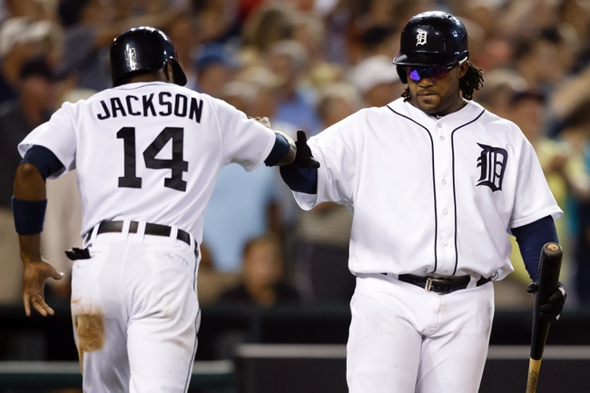 Aug 21, 2013; Detroit, MI, USA; Detroit Tigers center fielder Austin Jackson (14) receives congratulations from first baseman Prince Fielder (28) after scoring in the eighth inning against the Minnesota Twins at Comerica Park. Mandatory Credit: Rick Osentoski-USA TODAY Sports