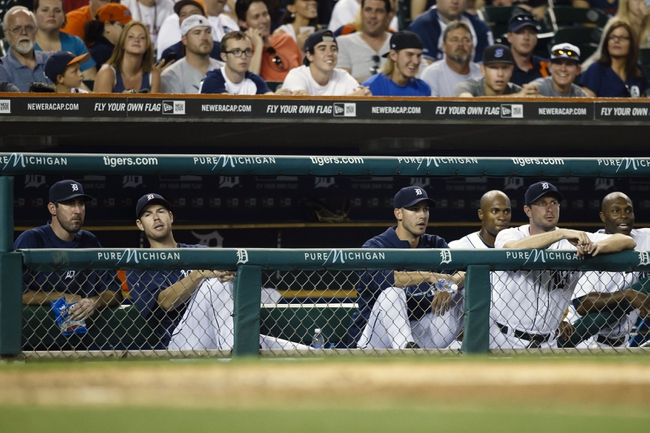 Aug 21, 2013; Detroit, MI, USA; Detroit Tigers starting pitcher Justin Verlander (left), starting pitcher Doug Fister (58), starting pitcher Rick Porcello (21) and starting pitcher Max Scherzer (37) watch from the dugout in the eighth inning against the Minnesota Twins at Comerica Park. Mandatory Credit: Rick Osentoski-USA TODAY Sports
