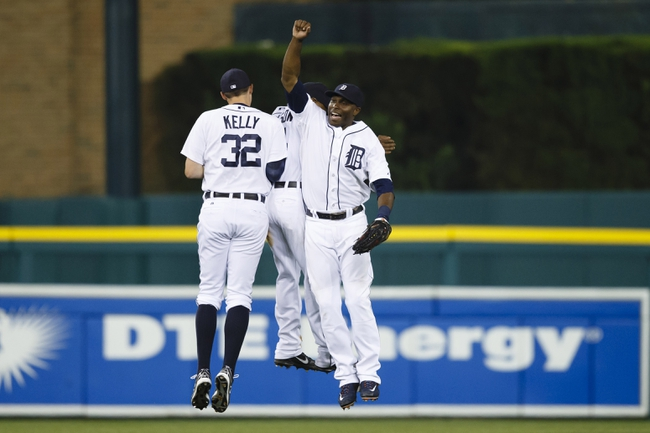 Aug 21, 2013; Detroit, MI, USA; Detroit Tigers left fielder Don Kelly (32), center fielder Austin Jackson (center) and right fielder Torii Hunter (right) celebrate after the game against the Minnesota Twins at Comerica Park. Detroit won 7-1. Mandatory Credit: Rick Osentoski-USA TODAY Sports