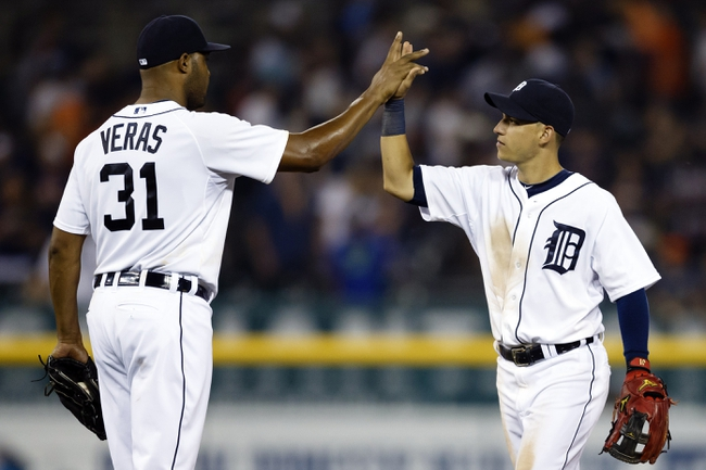 Aug 21, 2013; Detroit, MI, USA; Detroit Tigers relief pitcher Jose Veras (31) and shortstop Jose Iglesias (1) celebrate after the game against the Minnesota Twins at Comerica Park. Detroit won 7-1. Mandatory Credit: Rick Osentoski-USA TODAY Sports