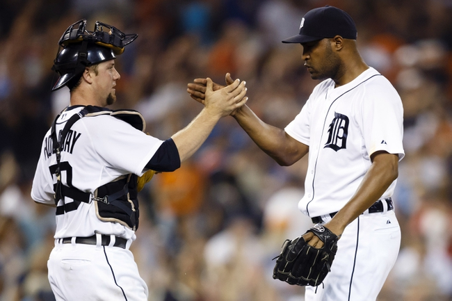 Aug 21, 2013; Detroit, MI, USA; Detroit Tigers catcher Bryan Holaday (50) and relief pitcher Jose Veras (31) celebrate after the game against the Minnesota Twins at Comerica Park. Detroit won 7-1. Mandatory Credit: Rick Osentoski-USA TODAY Sports