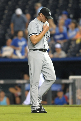 Aug 21, 2013; Kansas City, MO, USA; Chicago White Sox relief pitcher Addison Reed (43) reacts after the game against the Kansas City Royals at Kauffman Stadium. Chicago won 5-2. Mandatory Credit: Denny Medley-USA TODAY Sports