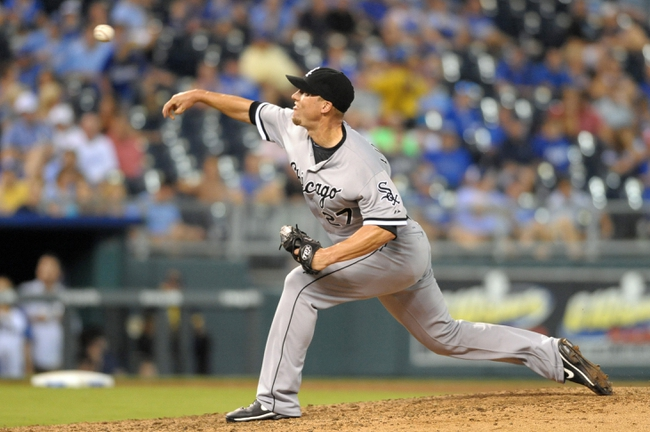 Aug 21, 2013; Kansas City, MO, USA; Chicago White Sox relief pitcher Matt Lindstrom (27) delivers a pitch in the seventh inning of the game against the Kansas City Royals at Kauffman Stadium. Chicago won 5-2. Mandatory Credit: Denny Medley-USA TODAY Sports