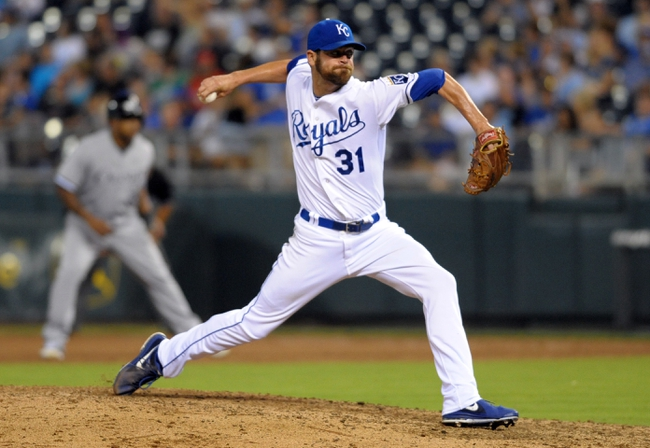 Aug 21, 2013; Kansas City, MO, USA; Kansas City Royals relief pitcher Louis Coleman (31) delivers a pitch in the seventh inning of the game against the Chicago White Sox at Kauffman Stadium. Chicago won 5-2. Mandatory Credit: Denny Medley-USA TODAY Sports