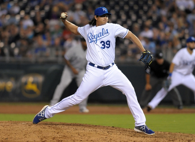 Aug 21, 2013; Kansas City, MO, USA; Kansas City Royals starting pitcher Luis Mendoza (39) delivers a pitch in the eighth inning of the game against the Chicago White Sox at Kauffman Stadium. Chicago won 5-2. Mandatory Credit: Denny Medley-USA TODAY Sports