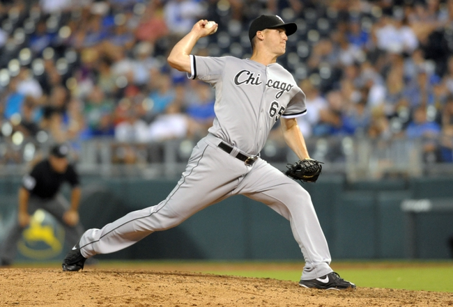 Aug 21, 2013; Kansas City, MO, USA; Chicago White Sox relief pitcher Nate Jones (65) delivers a pitch in the eighth inning of the game against the Kansas City Royals at Kauffman Stadium. Chicago won 5-2. Mandatory Credit: Denny Medley-USA TODAY Sports