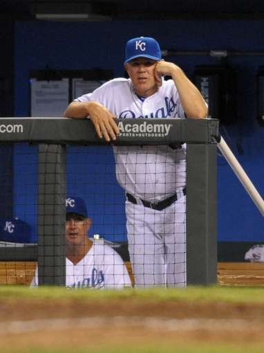 Aug 21, 2013; Kansas City, MO, USA; Kansas City Royals manager Ned Yost (3) watches game action in the eighth inning of the game against the Chicago White Sox at Kauffman Stadium. Chicago won 5-2. Mandatory Credit: Denny Medley-USA TODAY Sports