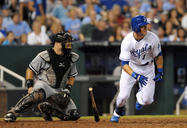 Aug 21, 2013; Kansas City, MO, USA; Kansas City Royals right fielder David Lough (7) connects for a one-run single in the sixth inning of the game against the Chicago White Sox at Kauffman Stadium. Chicago won 5-2. Mandatory Credit: Denny Medley-USA TODAY Sports