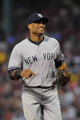 Aug 16, 2013; Boston, MA, USA; New York Yankees second baseman Robinson Cano (24) heads to the dugout during the third inning against the Boston Red Sox at Fenway Park. Mandatory Credit: Bob DeChiara-USA TODAY Sports