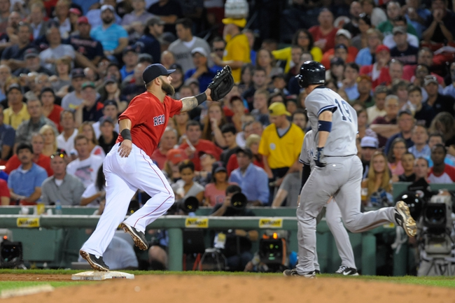 Aug 16, 2013; Boston, MA, USA; New York Yankees catcher Chris Stewart (19) avoids the tag of Boston Red Sox first baseman Mike Napoli (12) during the sixth inning at Fenway Park. Mandatory Credit: Bob DeChiara-USA TODAY Sports